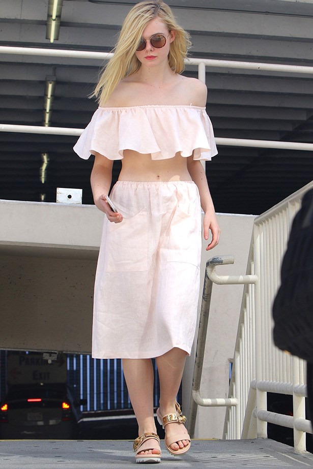 How sweet and summery is Elle Fanning in this cute ruffled two-piece? Bring on those dreamy, lazy summery days.