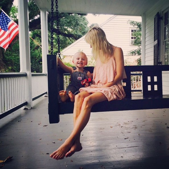 """Chris posted this lovely picture to Instagram: """"Happy boy, happy wife, happy life, porch swing. #CanIGetAHashTag <br> Proverbs 22:6"""" <br> <br> Babies in overalls? It's a yes from us. <br> <br> Image: <a href=""""https://instagram.com/p/2zaN0tjHPj/"""">Instagram</a>"""