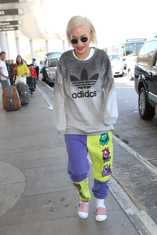 Rita Ora arrives at LAX looking comfy as hell in her Adidas sweats.