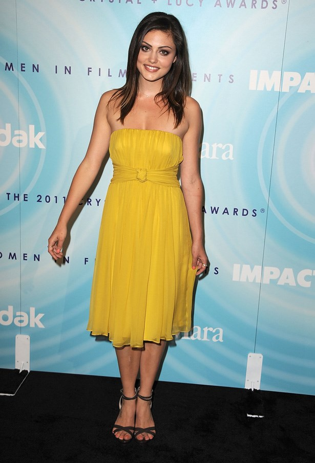 Tonkin wears a canary yellow dress.