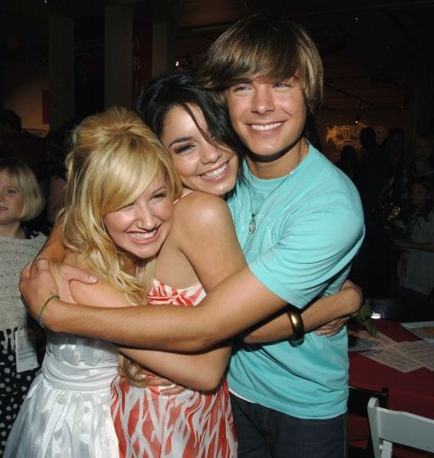 MAY 13, 2006 His hair is longer, the tooth gap is gone, and he's got a new girl squad hugging him. GETTY