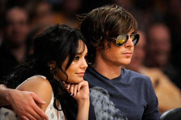 APRIL 19, 2009 Now, he's wearing sunglasses at an indoor basketball match with his girlfriend. Too cool for school. GETTY