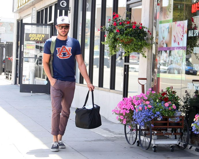 JUNE 11, 2012 Here he is, casually strolling down the street. He makes even purse duty look beautiful.</p>