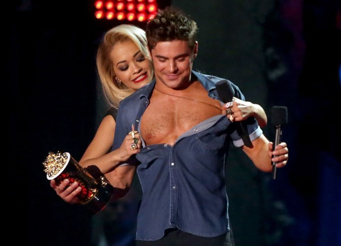 APRIL 13, 2014 THIS though, this is the best moment. Rita Ora does the world a favor and unveils Zefron's abs at the MTV Movie Awards. On live TV. GETTY