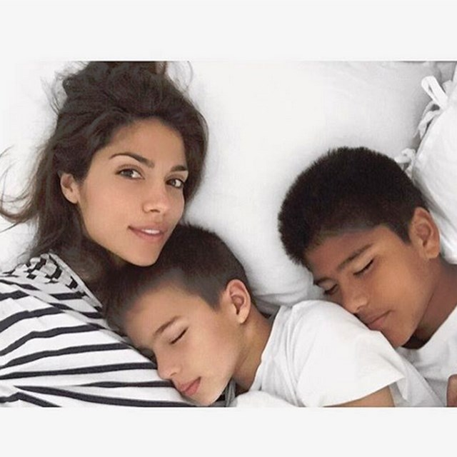 @piamiller and her boys tucked up in bed.