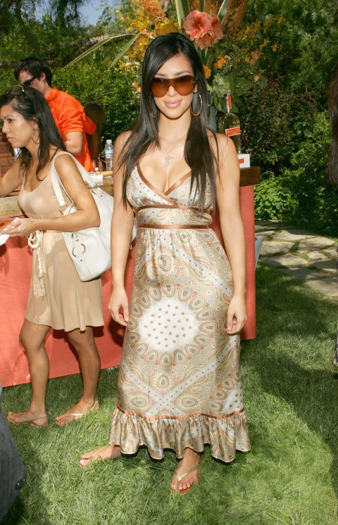 JULY 2006 Kim Kardashian loved large hoop earrings and sporty sunglasses in 2006.
