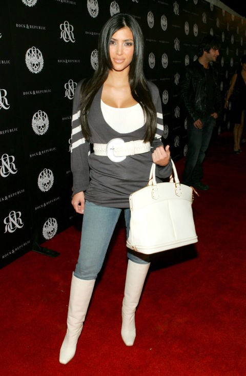 OCTOBER 2006 Remember when Kim matched her bag to her boots? By October, she was getting that belt involved too.