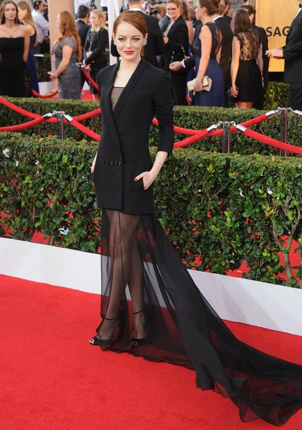 Emma Stone in a blazer-slash-dress creation by Dior.