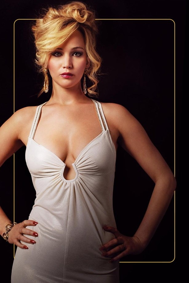 <em>American Hustle.</em> JLaw's kooky character in American Hustle was matched only by her incredible 70s gown.