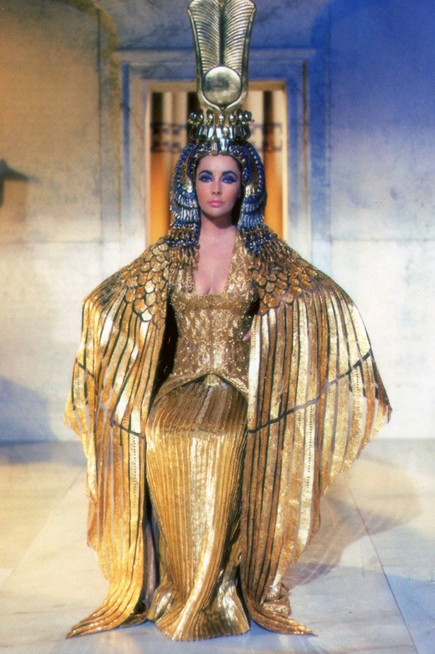 <em>Cleopatra.</em> Cleopatra's glittering gold dress, cape and crown in Cleopatra made her an instant icon.