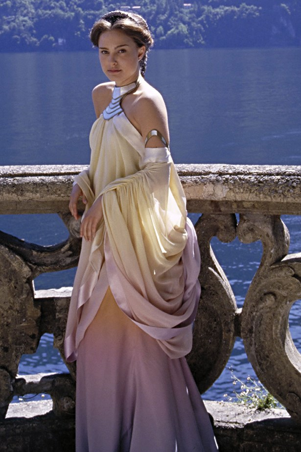 """<em>Star Wars.</em> Princess Leia's mum, Padme Amidala, didn't do too bad in the dress stakes either. Her pink and yellow ombre """"lakeside"""" dress has been touted as one of the most beautiful."""