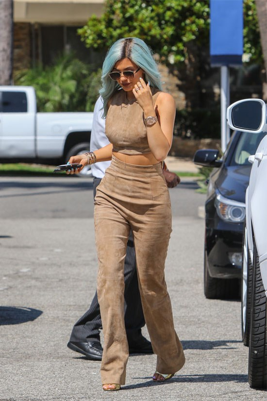 Kylie Jenner in a suede ensemble.