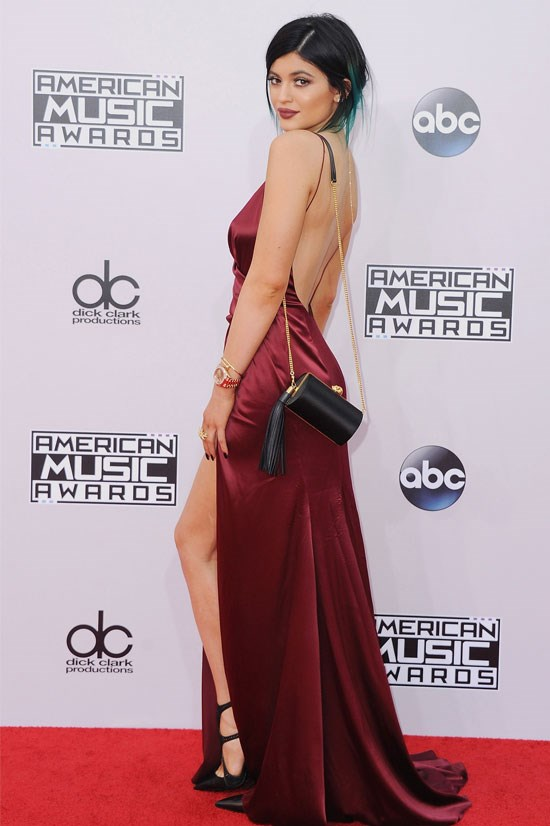 Kylie looks chic here in this burgundy silk gown at the 2014 American Music Awards.