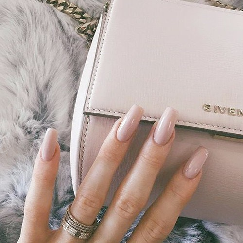 Kylie Jenner pioneered a new wave of dangerously impractical yet still cool nails, which are shaped into 'The Coffin' (right!).