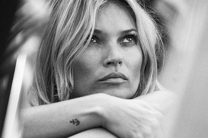 Kate Moss rocks a tiny anchor as well as her wings on her butt.