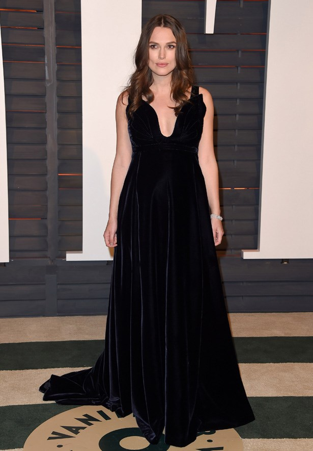 We don't usually see Knightly in a black dress but this velvet gown is something very special.