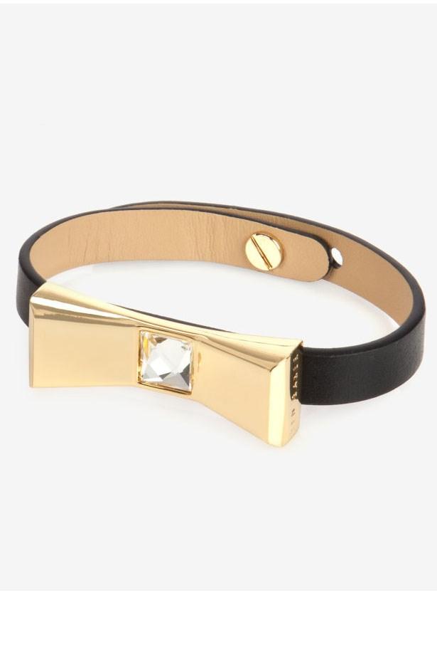 "Wrist band, $64.95, Ted Baker, <a href=""http://www.tedbaker.com/au/Mens/Gifts/Gifts-for-her/BOWELA-Leather-bow-bracelet-Black/p/116110-00-BLACK"">tedbaker.com/au</a>"