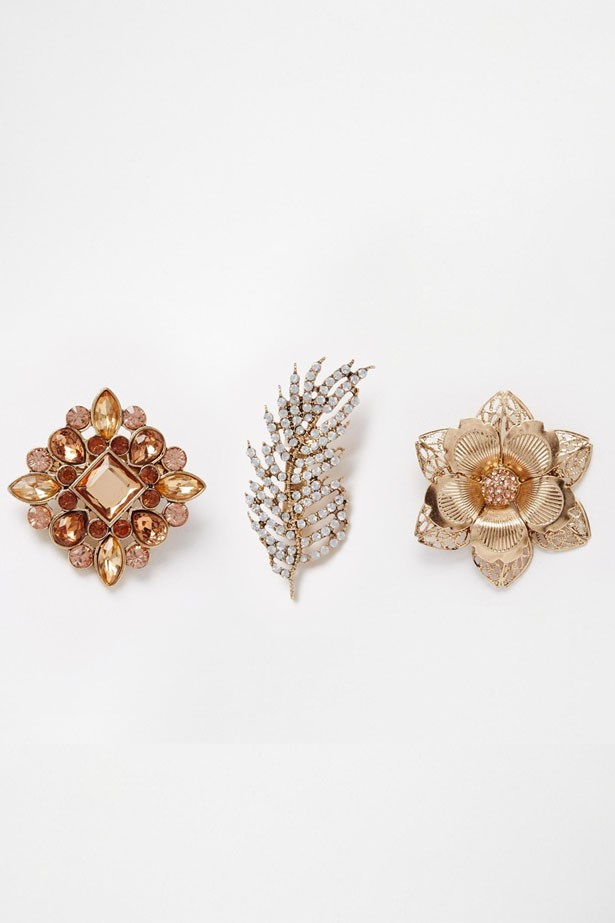 "3 Brooch set, $28, Asos.com,<a href=""http://www.asos.com/au/new-look/new-look-brooch-multi-pack/prod/pgeproduct.aspx?iid=5939489&clr=Lightbrown&SearchQuery=brooch&pgesize=21&pge=0&totalstyles=21&gridsize=3&gridrow=2&gridcolumn=2""> asos.com/au</a>"
