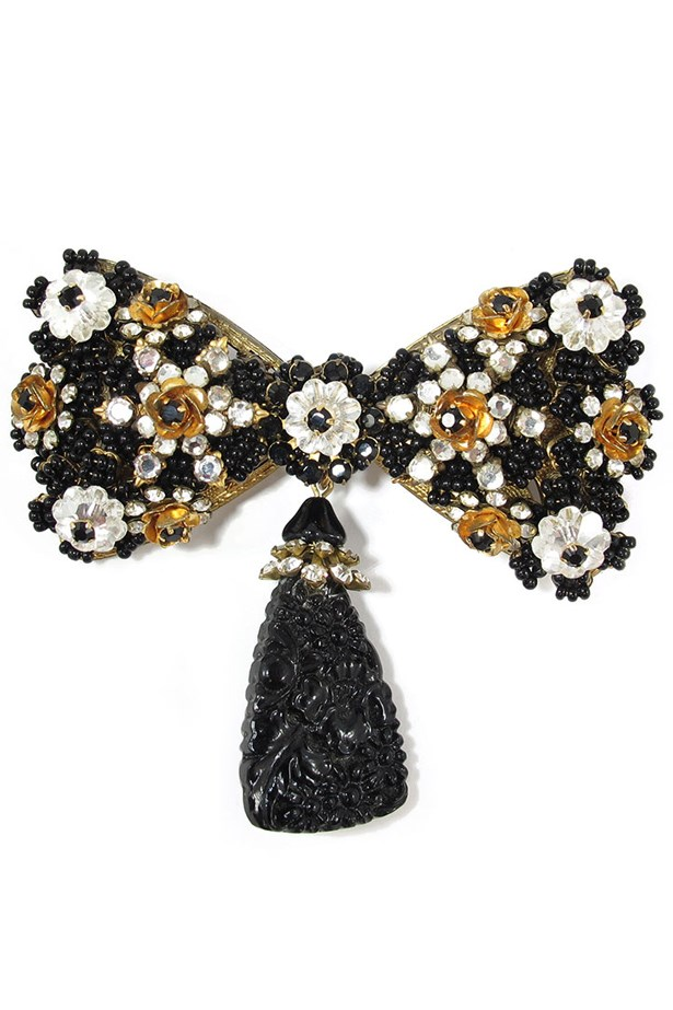 "Bow Brooch, $420, Stanley Hagler, <a href=""http://www.harlequinmarket.com/jewellery/brooches/vintage-signed-stanley-hagler-bow-brooch"">harlequinmarket.com</a>"