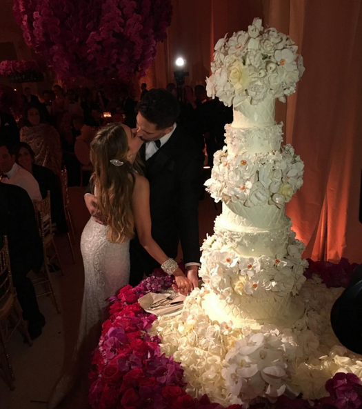 OK ONE MORE! Sofia Vergara shared this pic of her and her very handsome groom sharing a kiss next to their epic, extraordinary cake. Ah love, aint it grand (and Instagrammable).