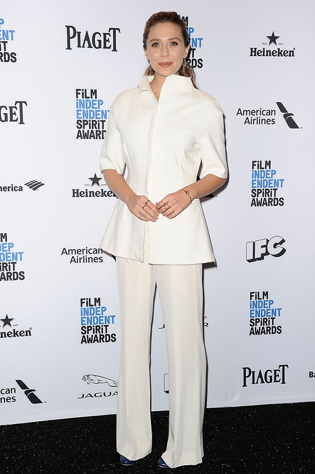 Elizabeth Olsen supports her sisters Mary Kate and Ashley in the chicest way possible, donning this perfect crisp ensemble from her sister's label, The Row. <br><br>That's a perfect summer look (for people who don't spill things) right there. Image: Getty