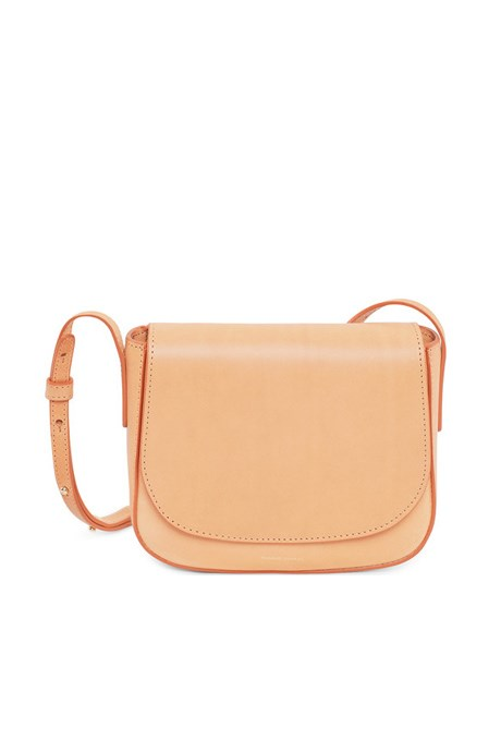 """Gift idea: Mansur Gavriel mini crossbody bag Who's it for: Your impossible fashion best friend.<br><br> She already has the latest season Gucci mules and she doesn't need anything, but that's not the point, right? Cult brand Mansur Gavriel is just the ticket – chic, minimal, covetable. <a href=""""https://www.mychameleon.com.au/mini-crossbody-bag-cammello-p-3850.html?typemf=women"""">My Chameleon</a> $615"""