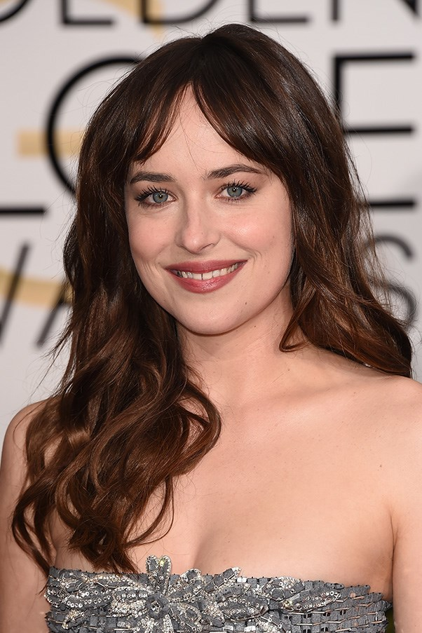 <strong>11th January </strong> <br><br><strong>Dakota Johnson</strong> looks adorable in an <strong>Aurbey Hepburn</strong>-esque parted fringe and light smokey eye for the <strong>72nd Annual Golden Globes</strong>.
