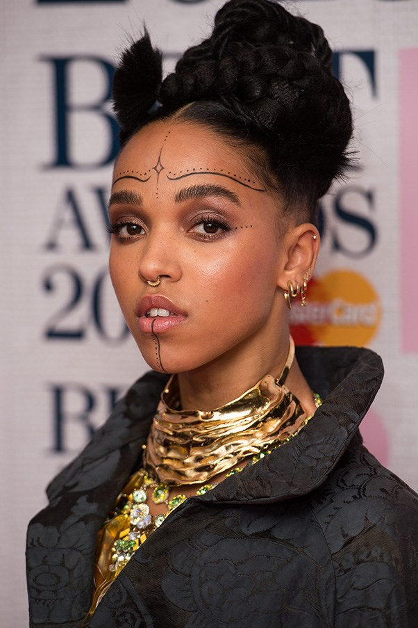 <strong>15th January </strong> <br><br>Always one to take risks on the red carpet, British singer<strong> FKA Twigs </strong>hypnotizes at the <strong>2015 Brit Awards Nominations Launch</strong>.