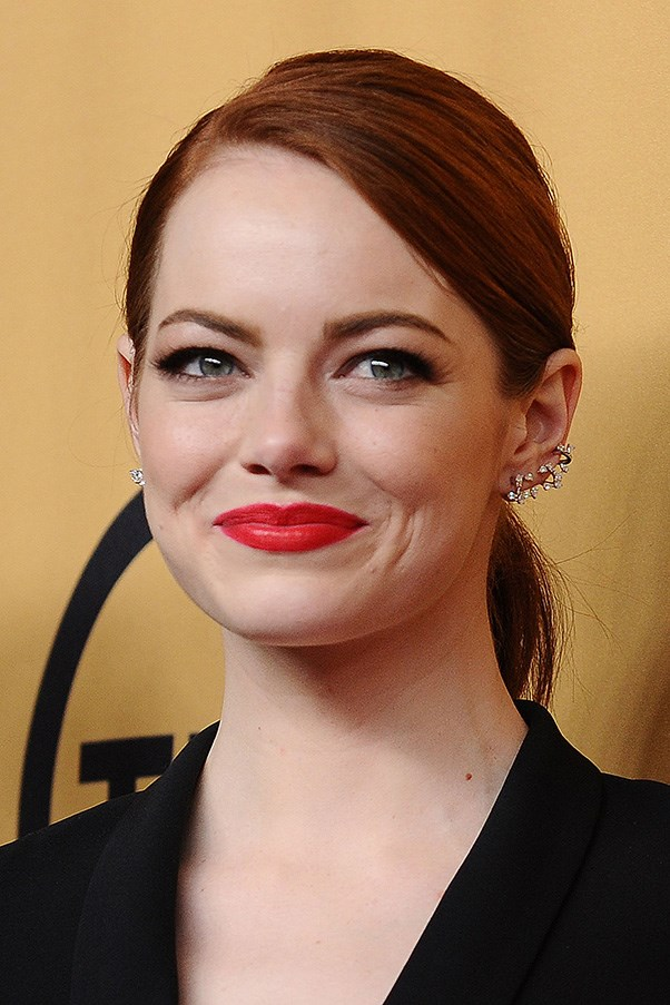 <strong>25th January </strong> <br><br><strong>Emma Stone</strong> pairs a side-parted pony with a bright red lip at the <strong>21st Annual Screen Actors Guild Awards</strong>.