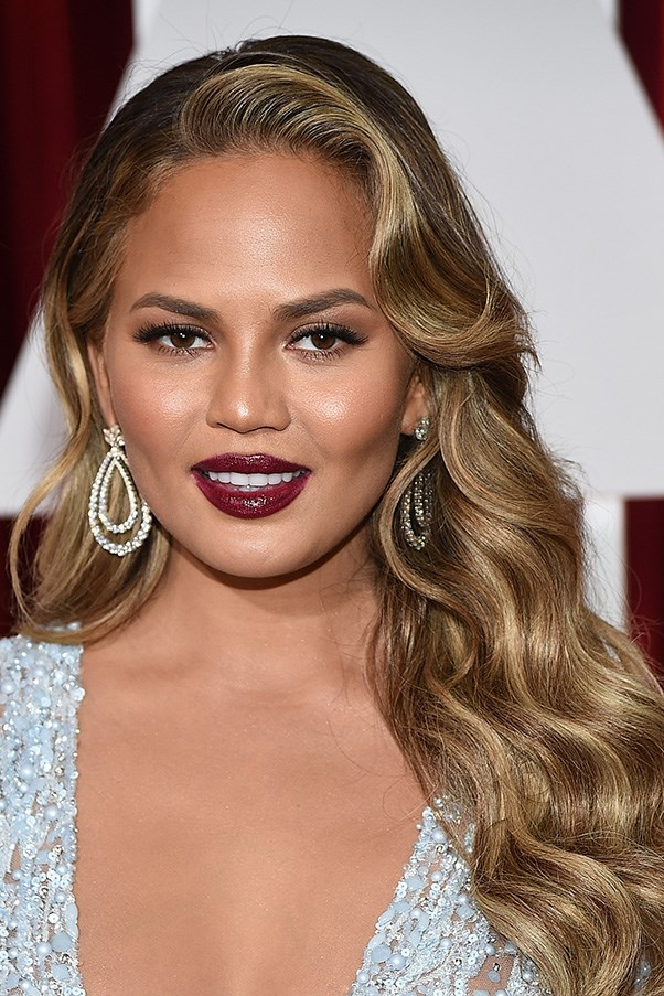 <strong>22nd February </strong> <br><br><strong>Chrissy Teigen</strong> exudes Hollywood glamour with cascading curls and a berry lip at the<strong> 87th Annual Academy Awards</strong>.