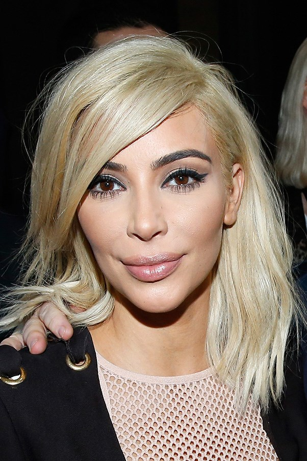 <strong>5th March </strong> <br><br><strong>Kim Kardashian</strong> shows off platinum locks and a feline flick during <strong>Paris Fashion Week</strong>.