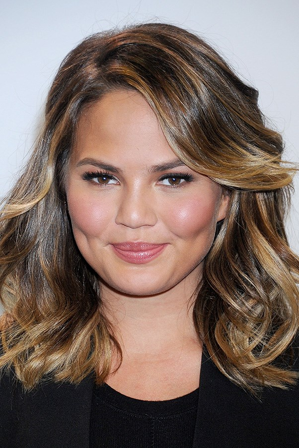 <strong>7th April </strong> <br><br><strong>Chrissy Teigen</strong> is the picture of effortless beauty with rosy cheeks and lips whilst announcing the finalists for the <strong>Billboard Music Awards</strong>.
