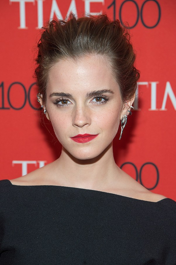 <strong>21th April </strong> <br><br>Edgy and chic, <strong>Emma Watson's </strong>messy up do showcases her ear bling, while her bold pout pulls the look together.