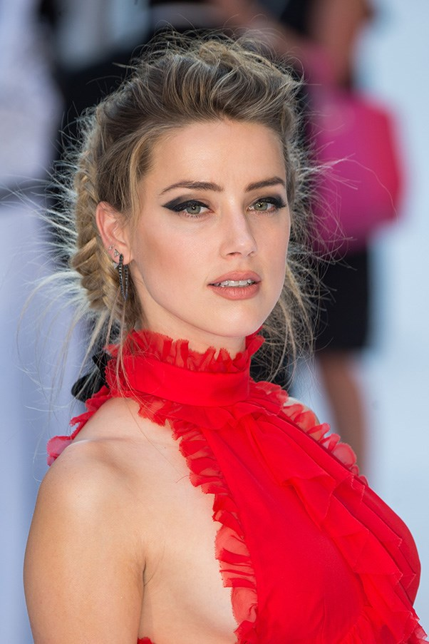 <strong>25th June </strong> <br><br><strong>Amber Heard's </strong>graphic liner and bronzed cheekbones are enhanced by a bold braid at the <strong>European</strong> premiere of <em>Magic Mike XXL</em>.