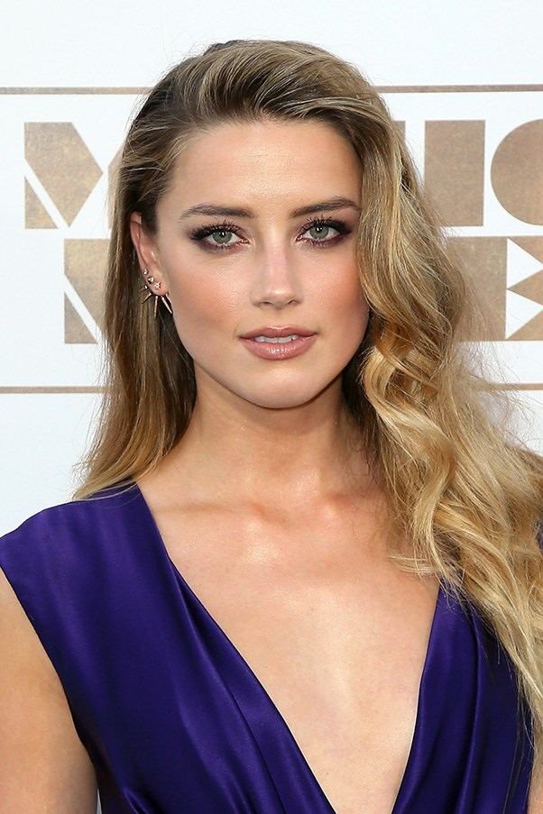 <strong>30th June</strong> <br><br> <strong>Amber Heard </strong>shows off her softer side with side swept curls and a subtle smoky eye.