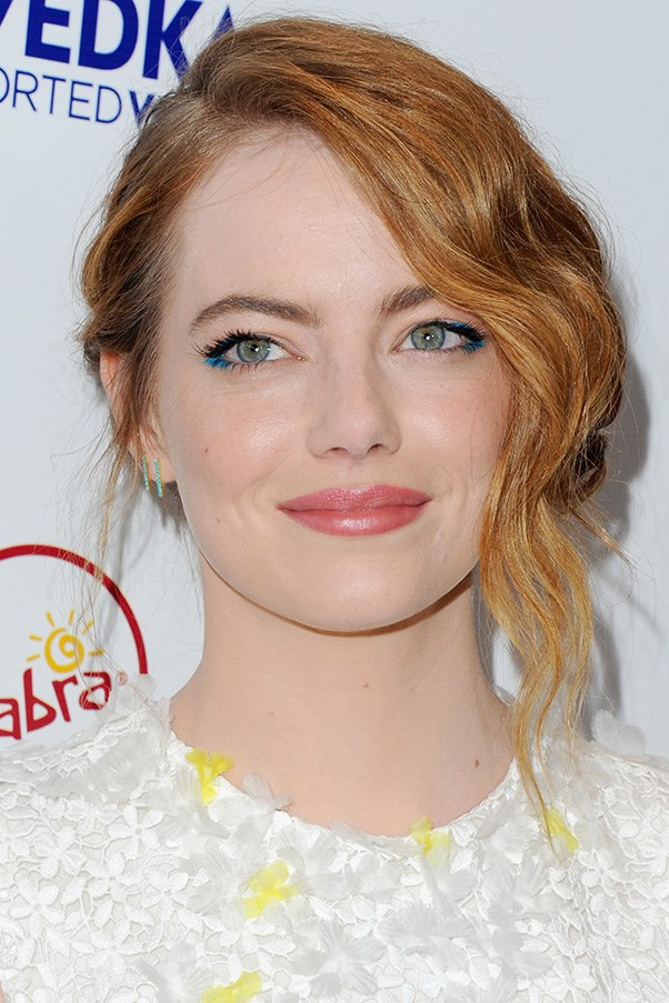 <strong>9th July</strong> <br><br><strong>Emma Stone</strong> embraces bold colour with a touch of blue eyeshadow and a coral lip at the premiere of<em> Irrational Man</em>.