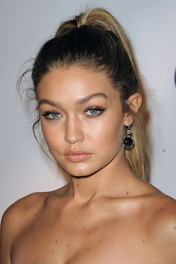 <strong>8th October </strong> <br><br>Wispy lashes and a peachy pout pop against<strong> Gigi Hadid's</strong> golden complexion at the <strong>Global Lyme Alliance Gala</strong>.