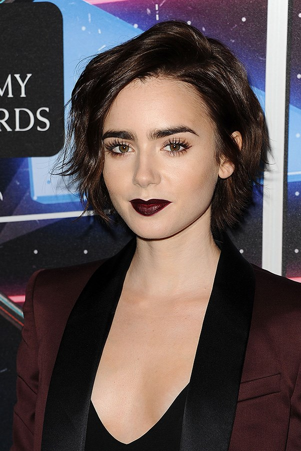 <strong>30th October </strong> <br><br><strong>Lily Collins </strong>embraces her dark side with a deep plum pout at the <strong>British Academy Britannia Awards</strong>.