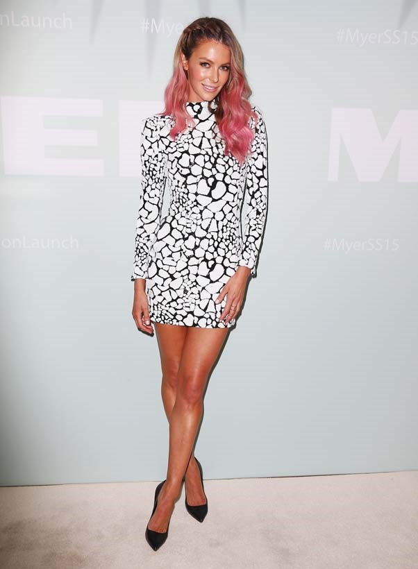 2014, August: Spicing up her black and white Balmain mini dress with pink tips at the MYER Spring Summer 2014 Fashion Launch in Sydney.