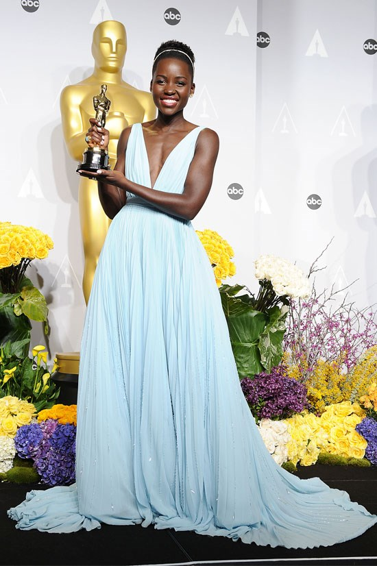 <strong>Lupita Nyong'o at the Oscars, 2014</strong> <br><br> Lupita was an emerging star this year, taking away the Oscar for best actress in a supporting role for her role in <em>12 Years a Slave</em>. She also looked absolutely perfect in this baby blue Prada gown.