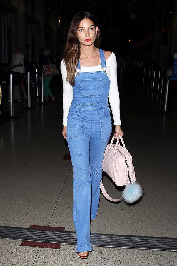 Lily Aldridge in denim dungarees.