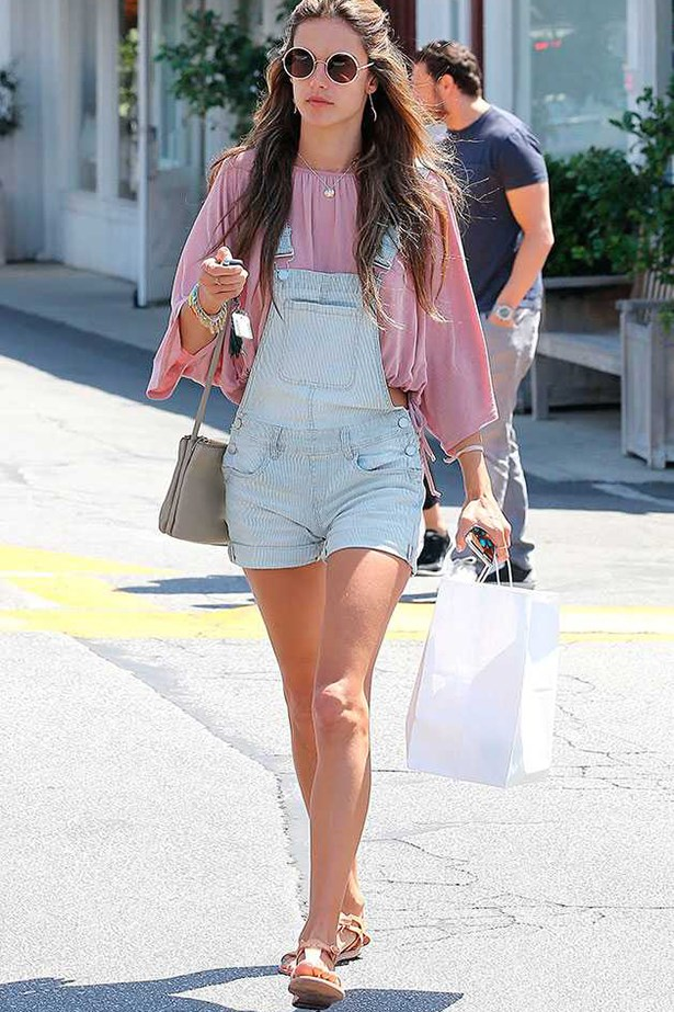 Alessandra Ambrosio <p> <p> Alessandra provides a masterclass in styling two of the season's key buys: a statement blouse and a set of dungarees.
