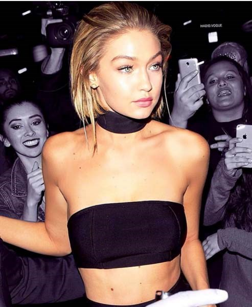 @gigihadid matches her top to her accessory... With seriously eye-catching results.