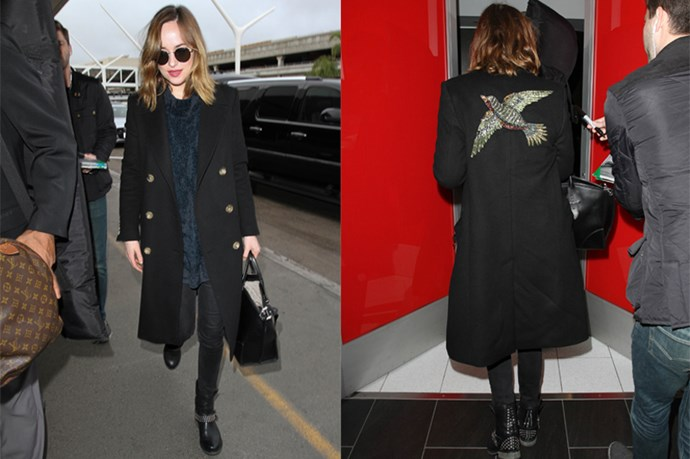 We're obsessed with Dakota's latest low-key look, which consists of a blue velvet sweater, plain black jeans, serious biker boots and the coolest Gucci bird-embellished coat.