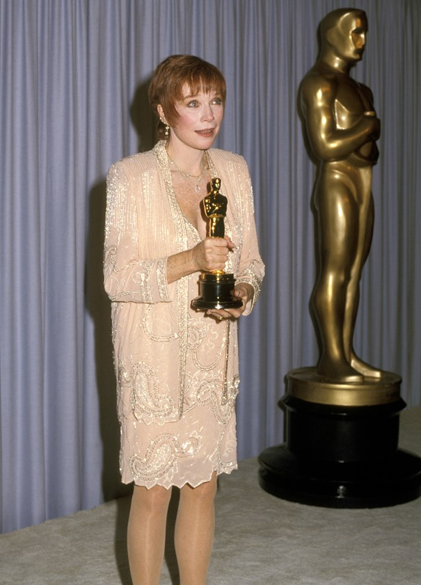 After being nominated five times, Shirley MacLaine finally took out the top prize in 1983 wearing a peach pink skirt suit.