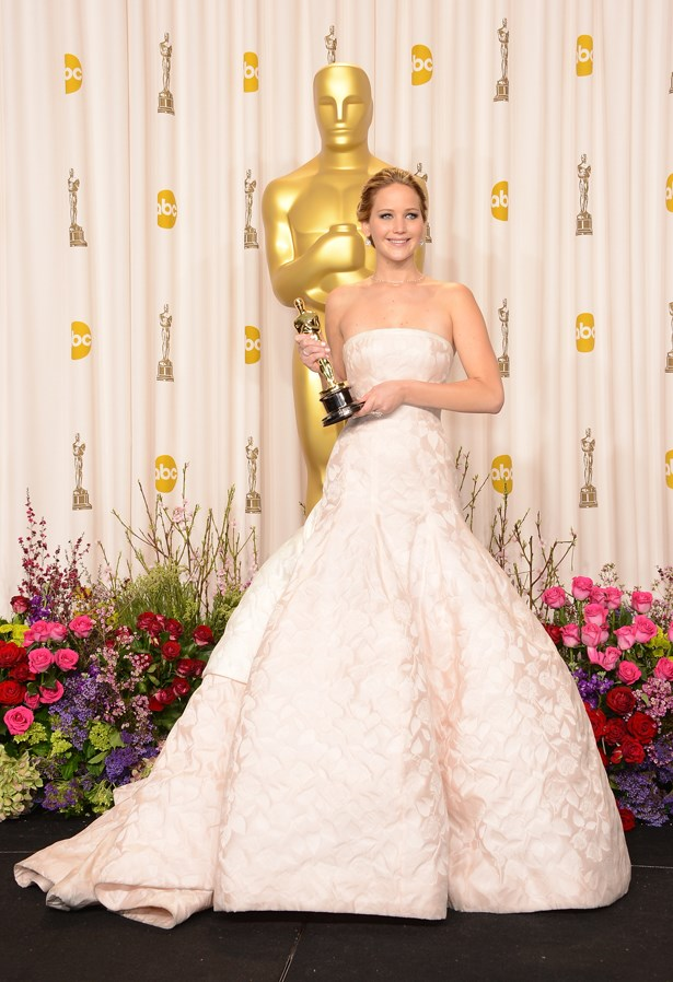 Jennifer Lawrence's white Dior gown was definitely a show-stopper - even though it tripped her up the stairs.