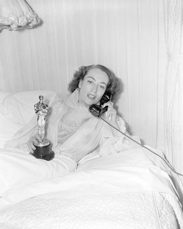 No, this isn't a gorgeous lace dress - it's actually a dressing gown. Joan Crawford didn't attend the ceremony to win her 1945 Oscar due to illness.
