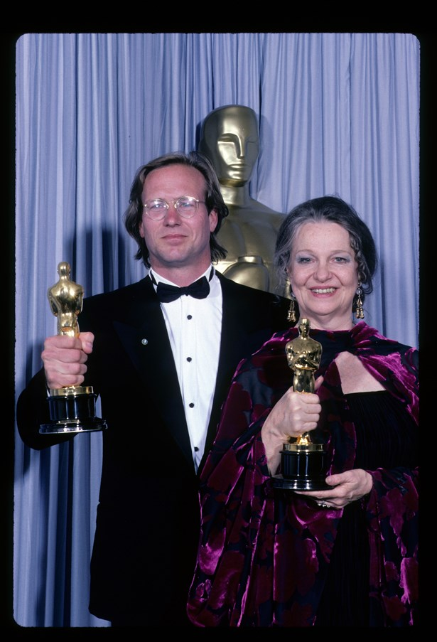 Geraldine Page wore a purple velvet gown with matching caplet in 1985.