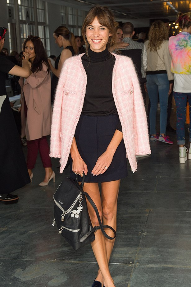Alexa Chung paired her black leather backpack with a pink overcoat.