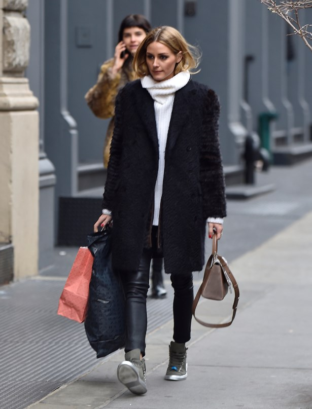 Olivia paired her white hoodie with a black coat, leather pants and sneakers in Paris.